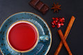 Red Tea With Beautiful Cup, Decorated With Cinnamon And Pomegran Royalty Free Stock Photography - 70234647