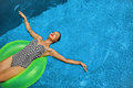 Summer Vacations. Woman Sunbathing, Floating In Swimming Pool Water Stock Image - 70251681