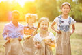 Group Of Kids At Sack Race Stock Photography - 70257692