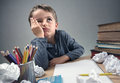 Bored And Fed Boy Up Doing His Homework Stock Photos - 70262003