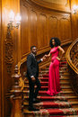 Beautiful African Couple Posing On The Vintage Stairs. Luxurious Theatre Interior Background Stock Photos - 70270763