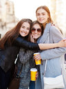 Three Young Women, Best Friends Smiling At The Camera Stock Images - 70285414
