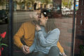 Couple In Love Kissing Behind The Window Of Cafe Stock Photo - 70299440
