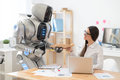 Pleasant Girl Getting Package From The Robot Stock Photography - 70313682