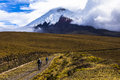 Two Mountain Bikers Riding In The Cotopaxi National Park Stock Photos - 70319283