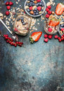 Breakfast In Jars. Oatmeal With Strawberries And Other Fresh Berries, Nuts And Seeds On Rustic Background, Top View Royalty Free Stock Photos - 70333408