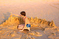 Preteen Boy Playing With Sand On The Beach Royalty Free Stock Images - 70333709