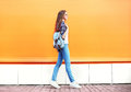 Fashion Woman Walking In City Over Colorful Orange Royalty Free Stock Images - 70333909
