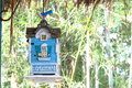 Decorative Hanging Blue House With A Bird On Top Stock Photo - 70342800