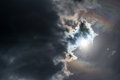 The Sun Peeking Out From Behind The Dark Clouds Royalty Free Stock Images - 70413559