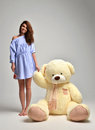 Young Beautiful Girl With Big Teddy Bear Soft Toy Happy Smiling Stock Photography - 70415662