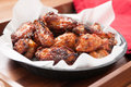 Hot Chicken Wings In A Basket Stock Photography - 70419022