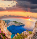 Navagio Beach With Shipwreck And Flowers Against Sunset On Zakyn Stock Image - 70433041