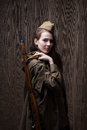 Woman In Russian Military Uniform With Rifle. Female Soldier During The Second World War. Stock Photography - 70433522
