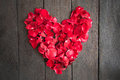Red Petal Roses Shaped Like A Heart On Wood Background, Stock Photo - 70475640