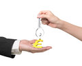 Woman Hand Giving Key Pound Symbol Keyring To Man Hand Stock Photos - 70480853