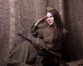 Woman In Russian Military Uniform With Rifle. Female Soldier During The Second World War. Royalty Free Stock Images - 70481319