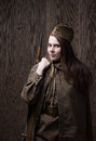 Woman In Russian Military Uniform With Rifle. Female Soldier During The Second World War. Stock Photos - 70481383
