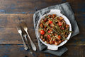 Roast Meat With Tomato, Onion And Rosemary On Frying Pan Royalty Free Stock Photo - 70499935