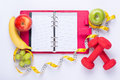 Workout And Fitness Dieting Copy Space Diary. Healthy Lifestyle Concept. Apple, Dumbbell, And Measuring Tape On Rustic Wooden Tabl Royalty Free Stock Image - 70500506