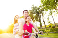 Happy  Family Having Fun In Park With Bicycle Stock Image - 70530011
