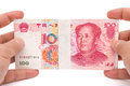Hand Holding Stacks Of 100 RMB Paper Currency With Clipping Path Royalty Free Stock Images - 70534019