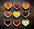 Nine Colorful Sauces And Marinades In Heart Shaped Bowls Stock Image - 70544261