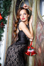 Portrait Of Beautiful Elegant Young Woman In Gorgeous Evening Dress Over Christmas Background Stock Photos - 70546033