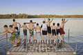 Group Of Kids Jumping Into Lake Royalty Free Stock Images - 70553519