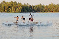Group Of Kids Jumping Into Lake Royalty Free Stock Photo - 70554205