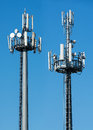Two Telecommunications Towers With Satellites Stock Images - 70571934