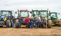 A Group Of Tractors Parked Up With Young Farmers Royalty Free Stock Image - 70575426