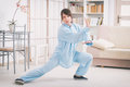 Woman Doing Qi Gong Tai Chi Exercise Royalty Free Stock Photo - 70619175