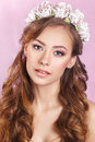 Beautiful Young Bride With A Floral Ornament In Her Hair.Beautiful Woman Touching Her Face. Youth And Skin Care Concept.Nymph. Stock Photos - 70619953
