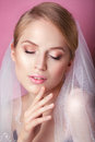 Beautiful Bride With Fashion Wedding Hairstyle - On Pink Background.Closeup Portrait Of Young Gorgeous Bride. Wedding. Studio Sho Royalty Free Stock Photography - 70621987