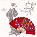 Japanese Geisha With A Plate Of Rolls In His Hand. Opened Fan With Flowers.  Royalty Free Stock Photo - 70634625
