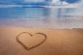 A Drawing Of A Heart On A Yellow Sand At A Beautiful Seascape Ba Stock Images - 70641174