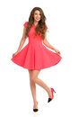Girl In Pink Mini Dress Posing On One Leg Stock Image - 70689691