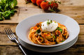 Italian Pasta With Poached Egg Stock Image - 70702981