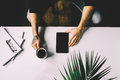 Man With Tattoo Holding  Tablet On Office Desk Table With , Supplies, Flower And Cup Of Coffee. Top View Stock Photography - 70712092