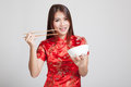Asian Girl In Chinese Cheongsam Dress With  Chopsticks Stock Image - 70744791
