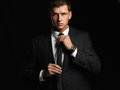Handsome Young Businessman Adjusting His Tie. Young Man In Suit Stock Images - 70745904