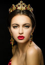 Beautiful Girl In A Golden Crown And Earrings On A Dark Backgrou Stock Image - 70779471