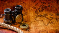 Old Vintage Retro Compass And Spyglass On Ancient World Map Stock Images - 70779504