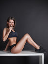Fit Pretty Woman Biting From A Chocolate Bar Royalty Free Stock Photos - 70797168