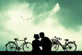 Couple With Bicycles At Sunset Royalty Free Stock Images - 70823099