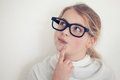 Young Girl With Glasses Thinking Royalty Free Stock Photo - 70831395