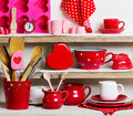 A Rustic Style. Ceramic Tableware And Kitchenware In Red On The Royalty Free Stock Images - 70856109