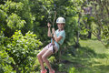 Happy Little Girl Riding A Zip Line In A Lush Tropical Forest Stock Photo - 70867410