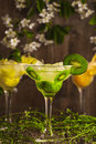 Three Cocktails: Pineapple, Orange, Kiwi. Fruit Soft Drink With Ice On A Wooden Background And Flowers Stock Photos - 70872373